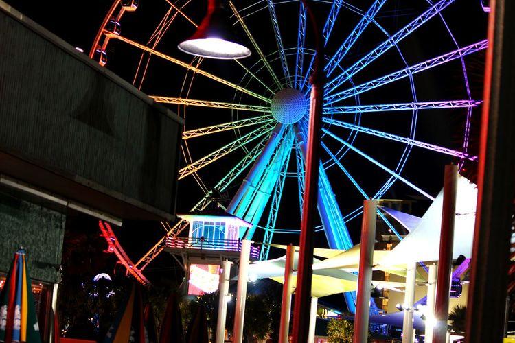 Night Low Angle View Arts Culture And Entertainment Amusement Park Illuminated Celebration Built Structure Amusement Park Ride Ferris Wheel No People Architecture