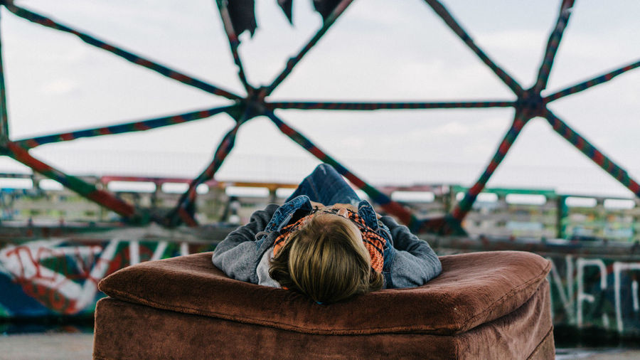 Alone Couch Adult Architecture Built Structure Day Focus On Foreground Headshot Hood - Clothing Leisure Activity Lifestyles Lying Down Men Nature One Person Outdoors Portrait Real People Rear View Relaxation Rest Seat Sky Teufelsberg Women