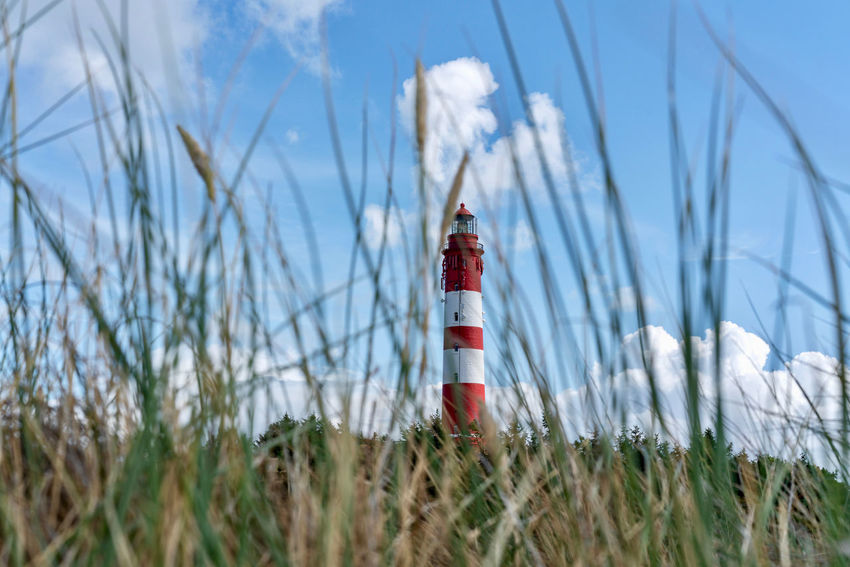 Clouds And Sky Grass Island Amrum Dunes Lighthouse The EyeEm Collection Premium Collection Getty Images Lighthouse Grass Cloud - Sky Building Guidance Lighthouse Safety Security Protection Sky Plant Built Structure Grass Tower Architecture Nature Building Exterior No People Direction Outdoors Land My Best Travel Photo
