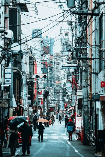 Osaka Rain City Architecture Built Structure Building Exterior Group Of People Real People Men City Life Street Walking People Day Adult The Way Forward Transportation Direction Crowd Lifestyles Motor Vehicle Outdoors