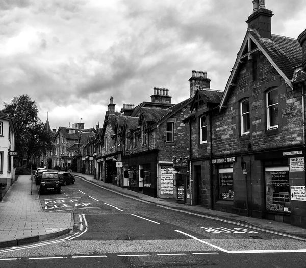 City street against cloudy sky