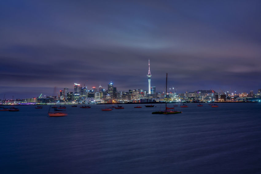 Auckland, New Zealand - August 20, 2018: Blue hour sunrise in Auckland, New Zealand. Building Exterior Built Structure Architecture Water Sky Waterfront Sea Illuminated City Cloud - Sky Nautical Vessel No People Nature Building Night Tower Cityscape Dusk Transportation Tall - High Skyscraper Office Building Exterior Outdoors Financial District  Auckland
