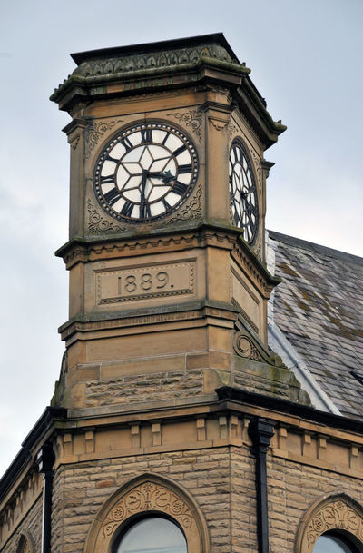 old co-op clock in hebden bridge Hebden Bridge Architecture Building Exterior Built Structure City Clock Clock Face Clock Tower Close-up Day History Hour Hand Low Angle View Minute Hand No People Outdoors Roman Numeral Sky Time Travel Destinations