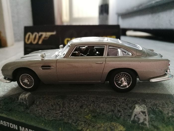 Collectors item from the James Bond 007 Goldfinger movie 🤗 Car Transportation Day No People Outdoors Racecar Close-up Retro Styled Land Vehicle The Car From The James Bond 007 Goldfinger Movie HuaweiP9Photography EyeEmNewHere Made By Noesie Collectorsedition Indoorsphotography No People Austin Martin Car Grey And Metal Color Collectors Item Collector's Car Indoors  Transportation Sport Auto Racing Old-fashioned 007collection The Week On EyeEm
