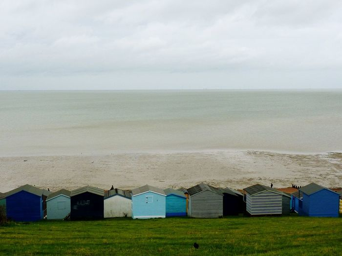 Colourful Beach Huts in Whitstable Reisefotografie Travel Photography Milky Sun Strandspaziergang I Like To Be At The Seaside Beach Life Colourful Gimme Shelter Strandhütten Beach Huts North Sea Coast Thames Estuary Themsemündung Kent Chelsea-by-the-Sea Whitstable Beach Sand Sky Day Outdoors Sea No People Horizon Over Water Multi Colored Beauty In Nature