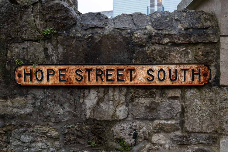 Hope Street South, an old weathered and rusting metal street name sign attached to an old stone masonry wall. Hope Architecture Building Exterior Built Structure Capital Letter Close-up Communication Day Guidance Hope Street Information Information Sign Message No People Outdoors Road Sign Rock Sign Solid Stone Wall Street Text Wall Wall - Building Feature Western Script