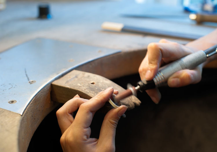 Close-up of jeweler making ring