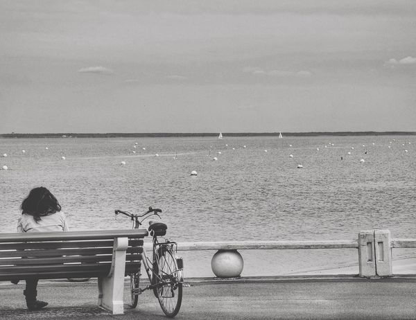 Assise à contempler... Bicycle Sea Water Horizon Over Water Transportation Mode Of Transport Beach Real People Outdoors Sky Day Nature One Person Beauty In Nature People From My Point Of View Excellent Shot EyeEm Best Shots EyeEmBestPics Exceptional Photographs Eye4photography  Minimalist Photography  Silhouette Portrait Of A Woman Woman