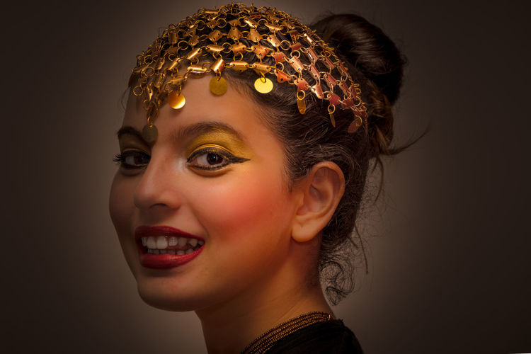 Like An Egyptian - Giovanna Arts Culture And Entertainment Beautiful People Beauty Black Background Cheerful Close-up Colored Background Fashion Females Girl Gold Gold Colored Headshot Human Body Part Human Lips One Person One Woman Only People Portrait Shiny Smiling Studio Shot