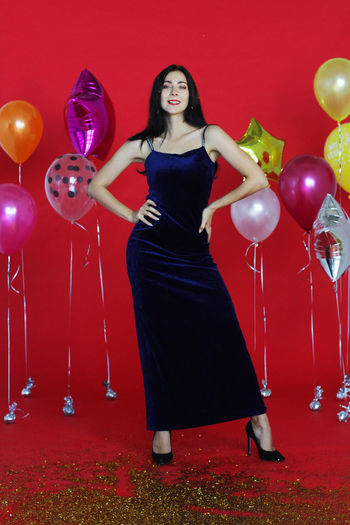 Full length of a young woman with balloons
