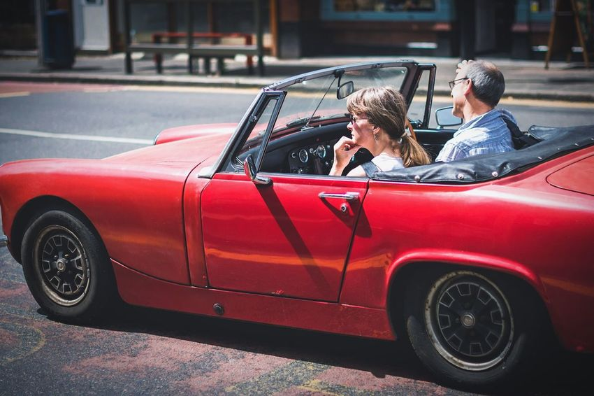On the road Car Transportation Red Convertible Land Vehicle Street Outdoors Day Two People Luxury Road City Cars Sportscar Sports Car Street Photography Streetphotography People