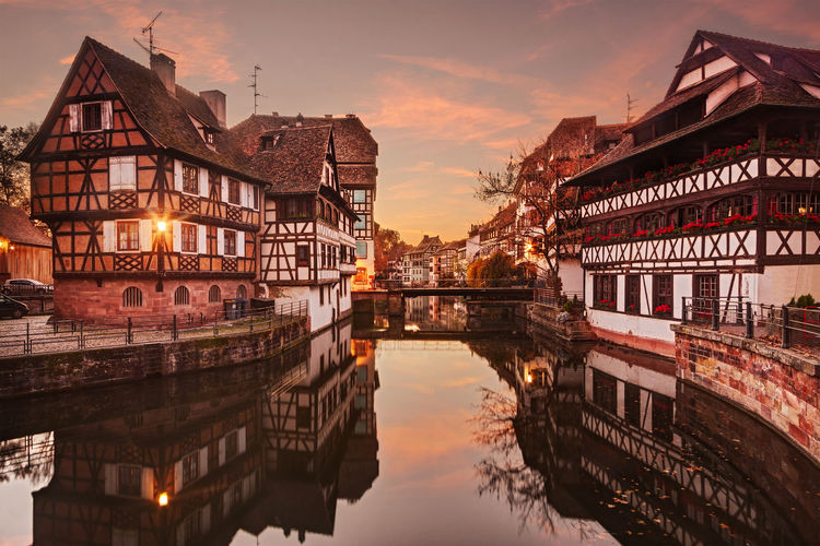 Strasbourg, Petite France at sunset. Strasbourg France Petit France Sunset Sunrise City Europe Cityscape Canal Architecture Half Timbered House Half Timbered Houses Water Travel Destinations Dusk Sky Building Building Exterior Built Structure Reflection No People