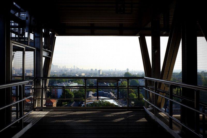 Cityscape Against Sky Seen Through Bridge