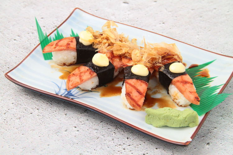 High angle view of sushi served in plate on table