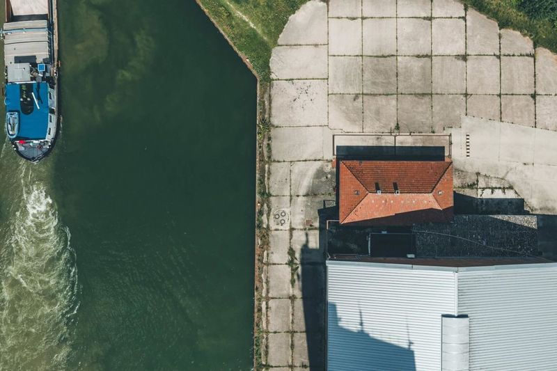 High angle view of canal by sea
