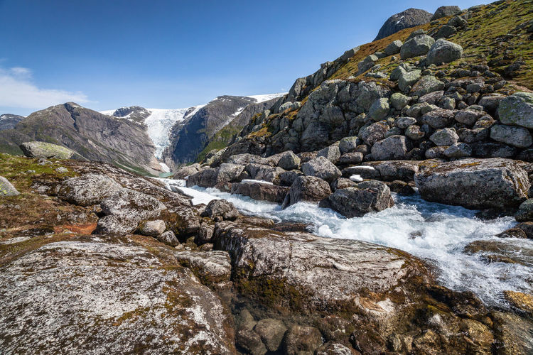 Hiking Jostedalsbreen Norway Beauty In Nature Blue Sky Day Flowing Flowing Water Glacier Hiking Adventures Land Motion Mountain Nature No People Non-urban Scene Outdoors Rock Rock - Object Rock Formation Scenics - Nature Sea Sky Solid Tranquility Water The Great Outdoors - 2018 EyeEm Awards