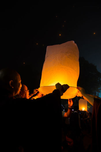 15 may 2014, Magelang, Indonesia : Participants releasing lanterns over the Borobudur temple in Magelang, Central Java during Vesak/Waisak Day celebrations. Bonfire Burning Fire Fire - Natural Phenomenon Flame Glowing Group Of People Heat - Temperature Holding Illuminated Lifestyles Lighting Equipment Men Motion Nature Night Orange Color Paper Lantern People Real People