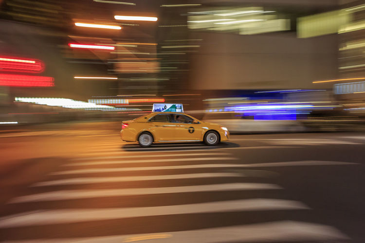 Life in the fast lane. Times square, Manhattan. Motion Blurred Motion Transportation Illuminated Mode Of Transportation Speed Car Architecture Night Long Exposure Land Vehicle Motor Vehicle City on the move Road Street Built Structure Building Exterior City Life Light - Natural Phenomenon Outdoors Taxi Yellow Cab New York City Pedestrian Crossing