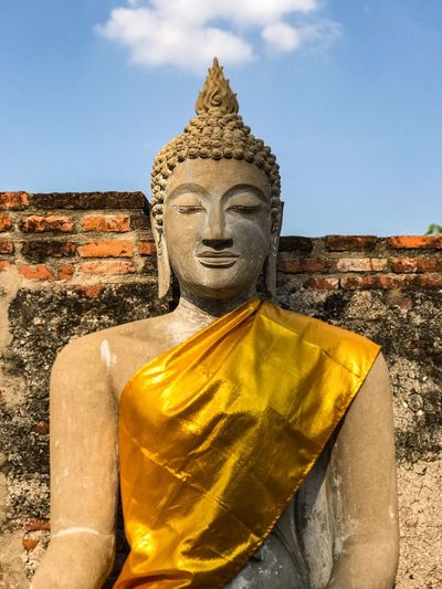 Statue Human Representation Religion Male Likeness Sculpture Spirituality Travel Destinations Old Ruin Idol Place Of Worship History Architecture Built Structure Sky Travel Day Low Angle View No People Outdoors Building Exterior Buddha Buddhalism Buddha Statue Portrait Wat Thai