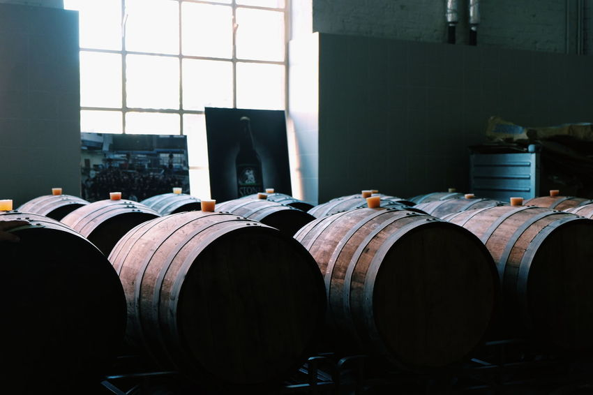 """These are barrels where Stone stores certain types of beer for extended periods of time so that aroma and flavour form nicely into """"arrogant"""" end product // Wine Cask Barrel Brewery Indoors  Alcohol Warehouse No People Craft Beer Stack DayCellar FUJIFILM X-T10 XF18-55mmF2.8-4 R LM OIS F/3.6 via Fotofall"""