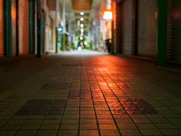 Absence Cobblestone Footpath Ishigaki  Japan Leading Lifestyles Men Narrow Pattern Pavement Paving Stone Real People Rear View Shadow Sidewalk Speed Street The Way Forward Walking Women