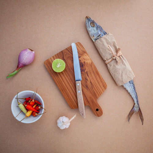 Close-up high angle view of knife and ingredient on table
