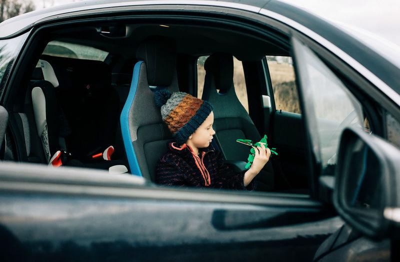 Portrait of boy in car window