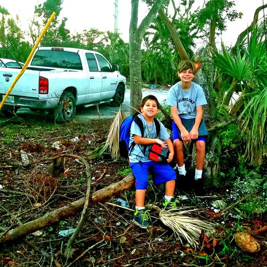 This is our bus stop now after Irma Florida Keys Ramrod Key Florida Hurricane Irma 2017 Key West Living Brothers Sibblings Childhood Car Smiling Bonding Teamwork Child Tree Young Adult Nature Sky Friendship People