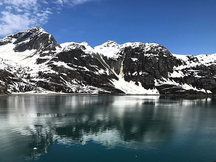 Scenic View Of Lake Against Mountain Range During Winter