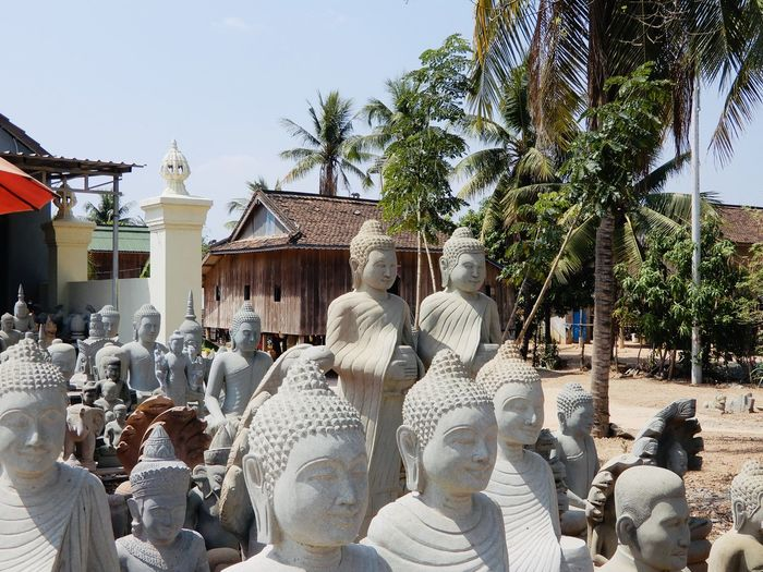 Panoramic shot of statues outside building
