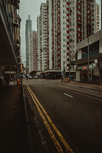 hongkong street City Building Exterior Architecture Built Structure Transportation Road Street Building Office Building Exterior Mode Of Transportation City Life Skyscraper Nature Sky Symbol No People Sign Rail Transportation Residential District Outdoors Cityscape Modern Track HongKong