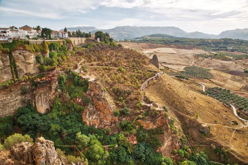Andalusian landscapes near Ronda, Spain Ronda, Spain Spaın River Tajo Puente Nuevo De Ronda Scenics Sky Sunrise Landscape Bridge River Sunset Beautiful Panorama Tree Trekking Hiking Tourism Mountain Hills Hills And Valleys Nature Scenics - Nature