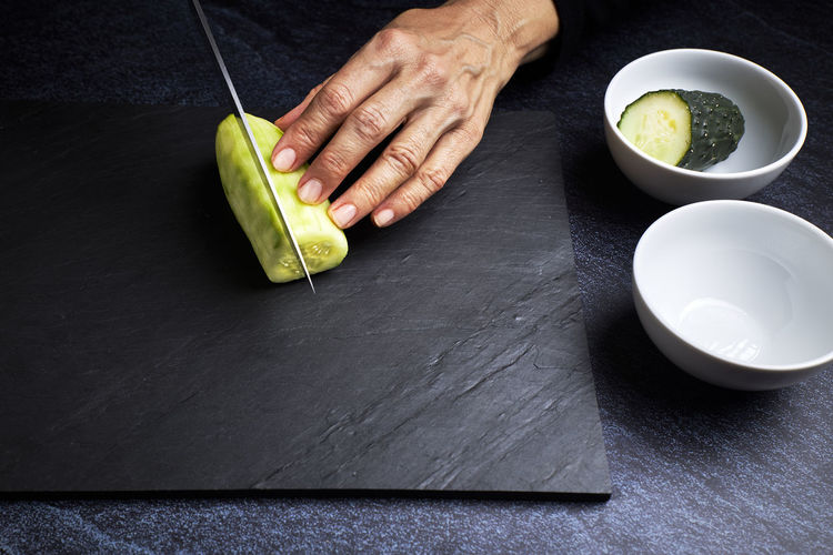 High angle view of person preparing food on table