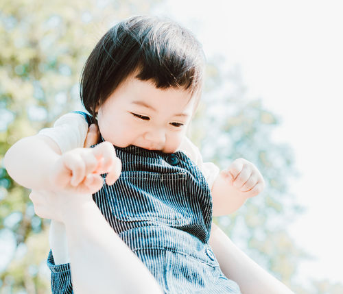 Casual Clothing Childhood Close-up Day Focus On Foreground Holding Human Hand Innocence Lifestyles One Person Outdoors People Real People Tree