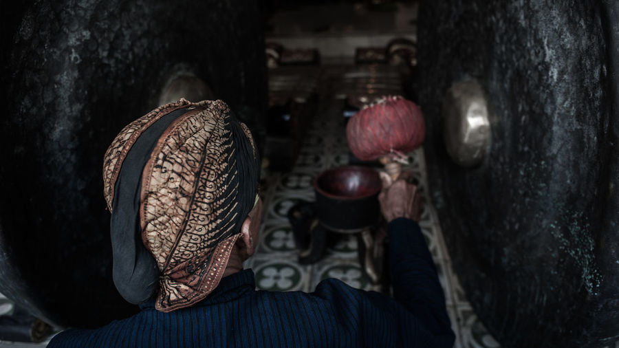 Antique Culture From Behind Gong Headpiece Hit Iron Java Javanese Man Moody Music Musician Old Old-fashioned Orchestra Peaceful Person Serenity Sound Traditional Traditional Costume Traditional Culture Gamelan