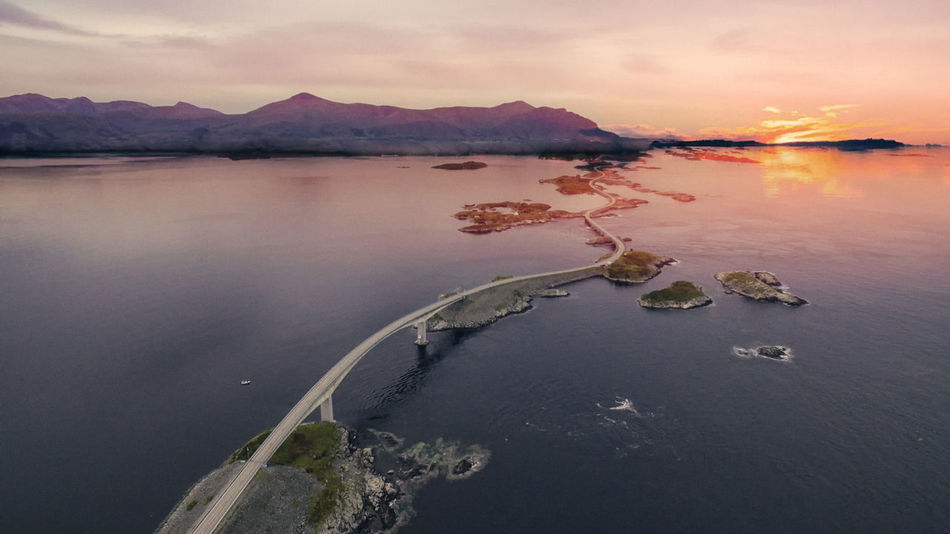 Drone  Norway Norway🇳🇴 Road Atlantic Road Beauty In Nature Cloud - Sky Drone Photography Dronephotography Dusk Highway Idyllic Mountain Nature No People Reflection Rock Scenics - Nature Sea Sky Sunrise Sunset Tranquil Scene Tranquility Water