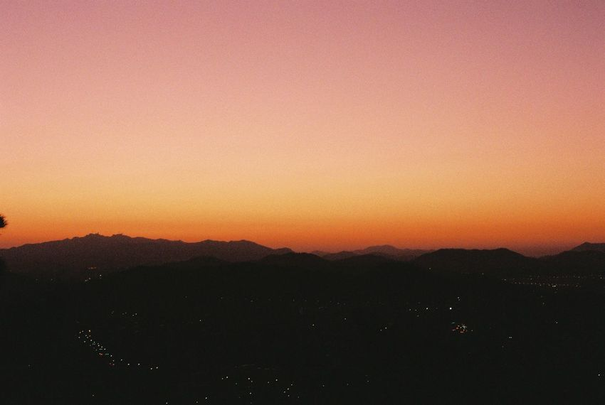 Film Beauty In Nature Clear Sky Film Photography Landscape Mountain Mountain Range Nature No People Outdoors Scenics Silhouette Sky Sunset Tranquil Scene