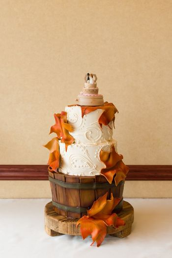 Fall Wedding Cake With Wood And Leaf Accents. Autumn Autumn Colors Autumn Leaves Beautiful Celebration Dessert Frosting Green Groom Wedding Wedding Photography Bakery Baking Bride Cake Fall Food Indoors  Kitchen Leaf Leaves Meringue No People White Wood - Material