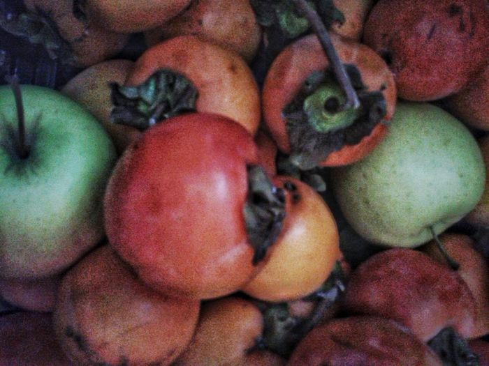 Autumn fruits. Kaki and apples. Autumn Autumn Fruits Autumn colors Bio Cachi Mele  Khaki Persimmons Kaki Orange Color From Above  Fruit Vegetable Red Close-up Food And Drink Full Frame