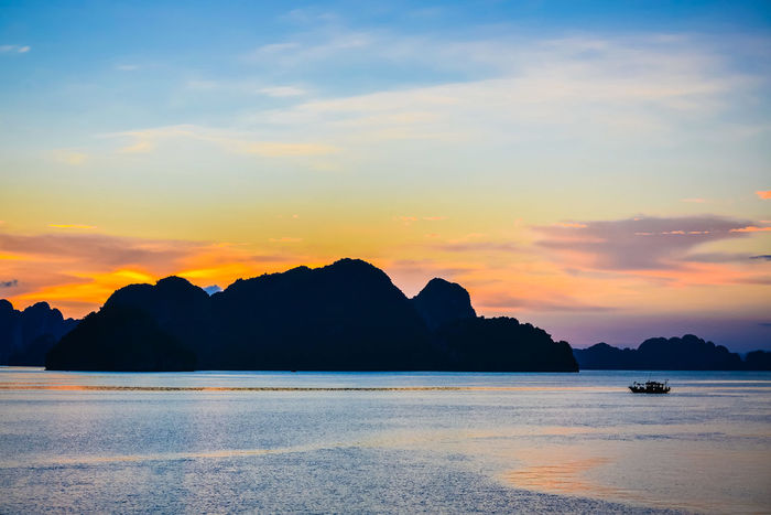 Tiny boat on Ha Long Bay's sunset - 2013 Cloud Life Nature Tiny Boat Landscape Moutain See Sky Sunset Water EyeEmNewHere Paint The Town Yellow Lost In The Landscape Been There. HUAWEI Photo Award: After Dark
