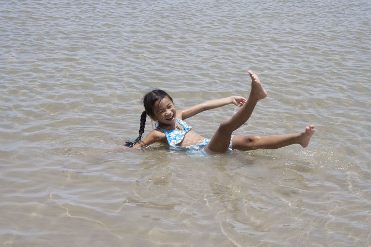 High angle view of girl playing at beach
