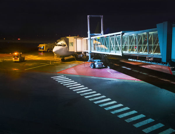 Airport, gate of boarding bridge Boarding Plane Air Vehicle Aircraft Airline Airplane Airport Arrival Boarding Bridge Connection Departure Illuminated Jet Journey Loading Mode Of Transport Night No People Outdoors Road Tarmac Terminal Transportation Unoading