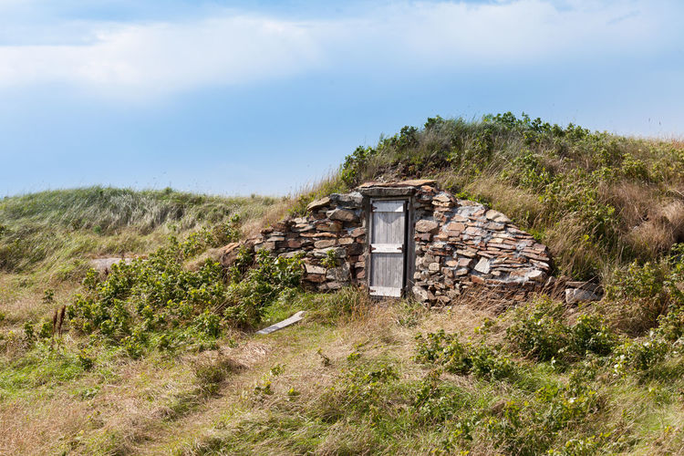 Historic vintage root cellar dug underground in barren grass landscape near Elliston, Newfoundland, NL, Canada Historic Vintage Old Earth Root Cellar Dugout Elliston Newfoundland NL Canada Underground Door Cold Storage Traditional Building Exterior Exterior Building Architecture Built Structure Grass Nature No People Outdoors Plant Land Environment Abandoned History Scenics - Nature The Architect - 2019 EyeEm Awards