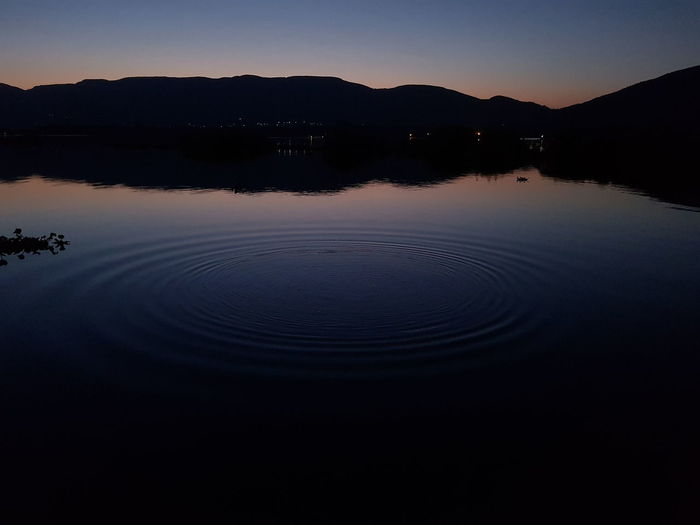 Reflection Silhouette Water Nature Beauty In Nature Tranquility No People Landscape Sunset Scenics Sky Lake Outdoors Astronomy Night Clear Sky Swimming Mammal Hartbeespoort Dam Hartebeespoort EyeEm Selects Perspectives On Nature