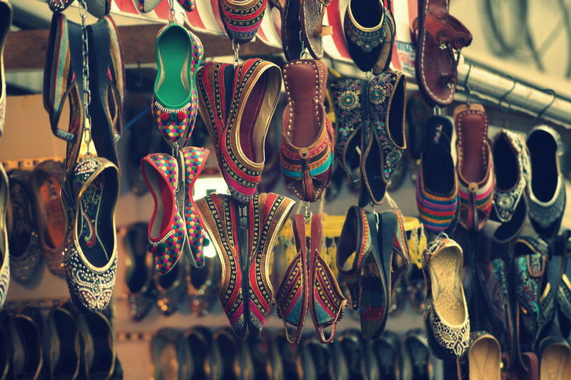 Close-up of shoes hanging at store