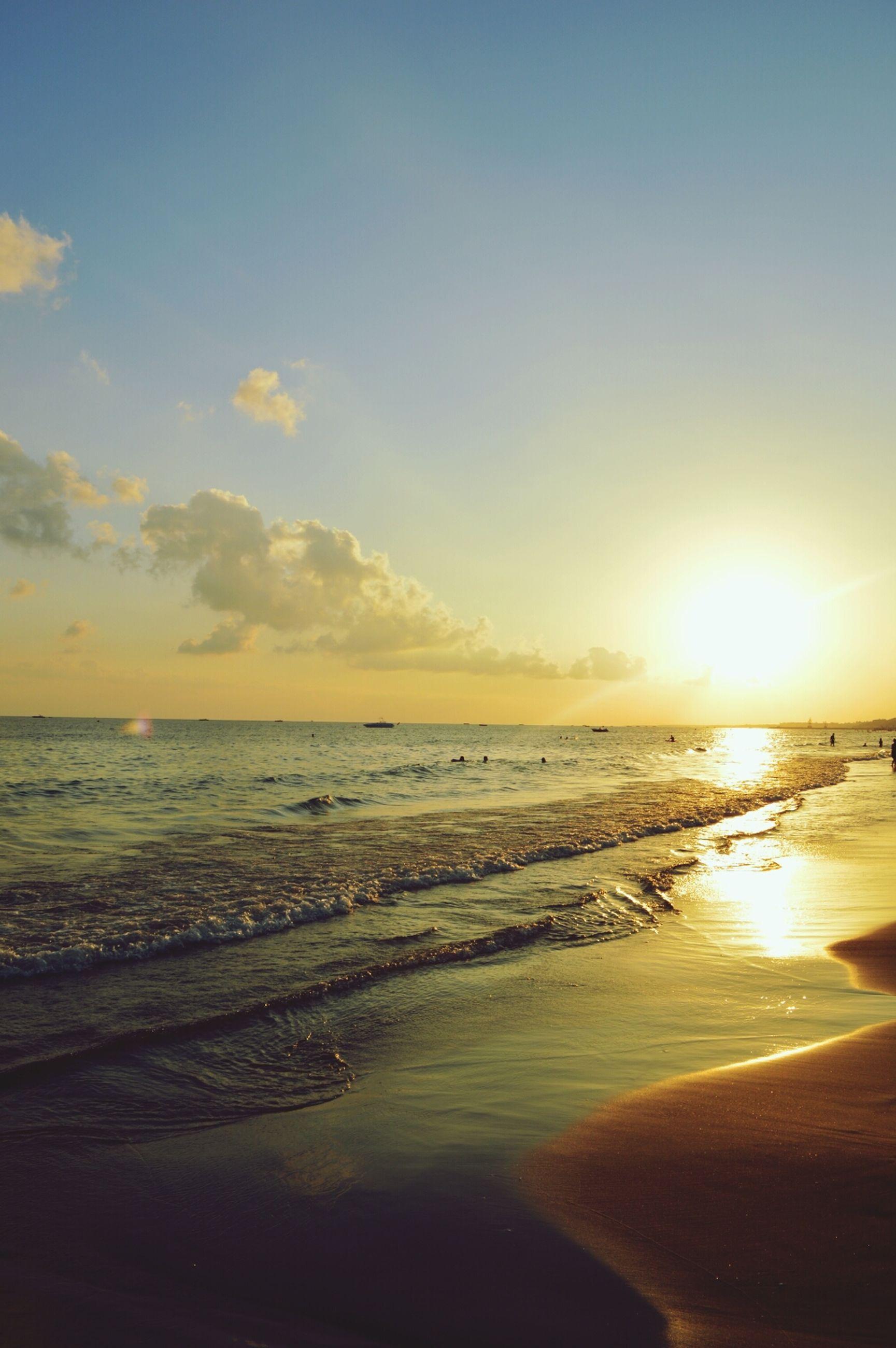 sunset, sea, beach, water, horizon over water, sun, scenics, tranquil scene, beauty in nature, tranquility, shore, sky, nature, orange color, idyllic, sunlight, sand, reflection, coastline, outdoors