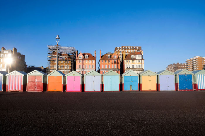 Brighton Beach Scaffolding Architecture Beach Huts Blue Brighton Beach Huts, Brighton Promenade Brighton Uk Brightonbeach Building Exterior Built Structure Clear Sky Day Get Away From It All Hut Huts Mult Coloured Multi Colored No People Outdoors Scaffolding, Outside, Architecture, Sky