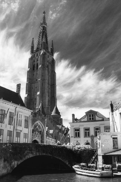 Happy evening 😊 Architecture Religion Cathedral Low Angle View Sky Travel Destinations Cloud - Sky Clouds Clouds And Sky Blackandwhite Blackandwhite Photography Gothic Style Façade City Church Place Of Worship Picsartrefugees Belgium Brugge Brüggesehenundsterben Bruges