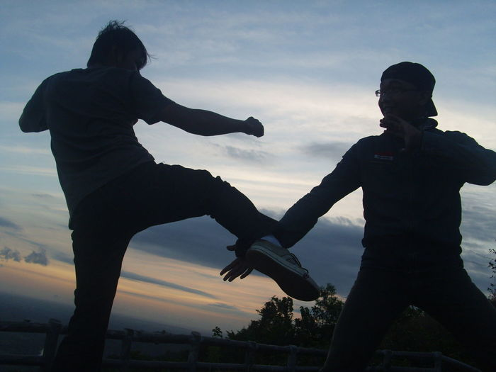 Fight Bonding Cloud - Sky Enjoyment Friendship Full Length Fun Human Arm Leisure Activity Lifestyles Men Nature Outdoors Pencak Silat People Real People Silat Silhouette Sky Sunset Togetherness Two People Young Men Adventures In The City