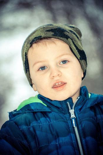 Portrait of cute boy in snow